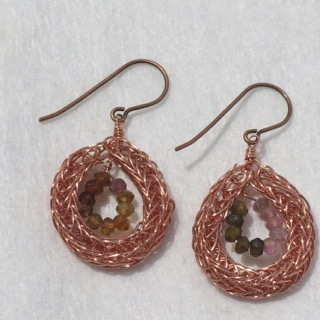 A 73 - Bondi Studio                                              Anita Blalock Viking knit copper, stealing silver chains with crystals, gems in the knitted wire and as pendants.
