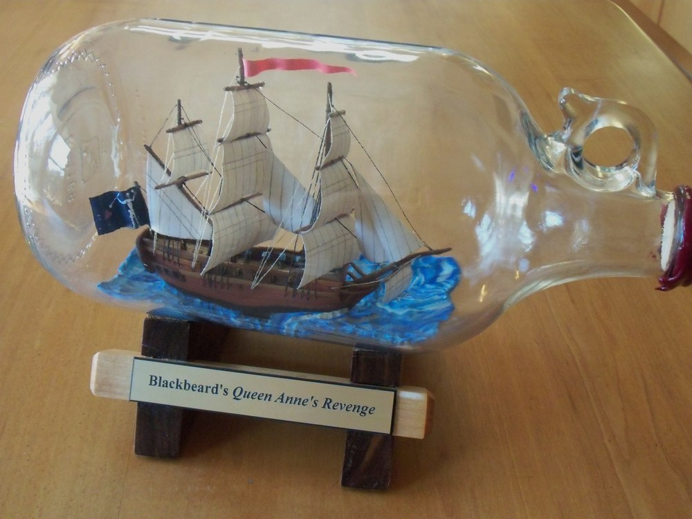 B 48 - Carolina Ships in Bottles                             Jim Goodwin Handcrafted historic ships & lighthouses in bottles made w/ traditional insert thru mouth method.