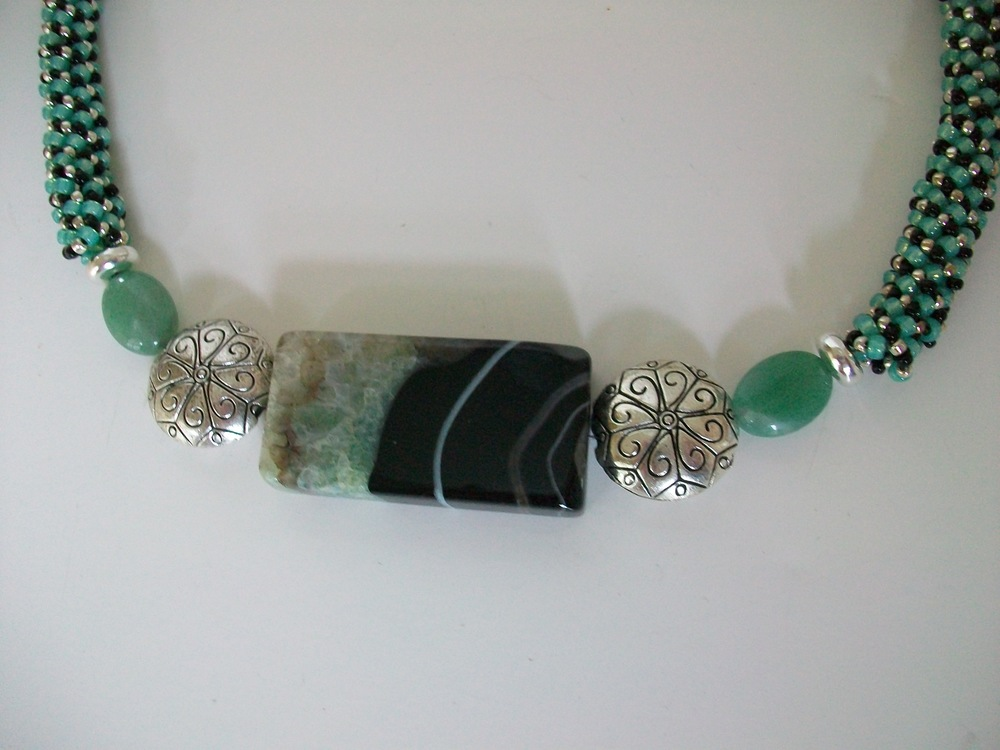 A 78 - Design Trends Jewelry                                          Kathy Emerson Gemstone beads of different shapes and colors. All of the jewelry is handmade.