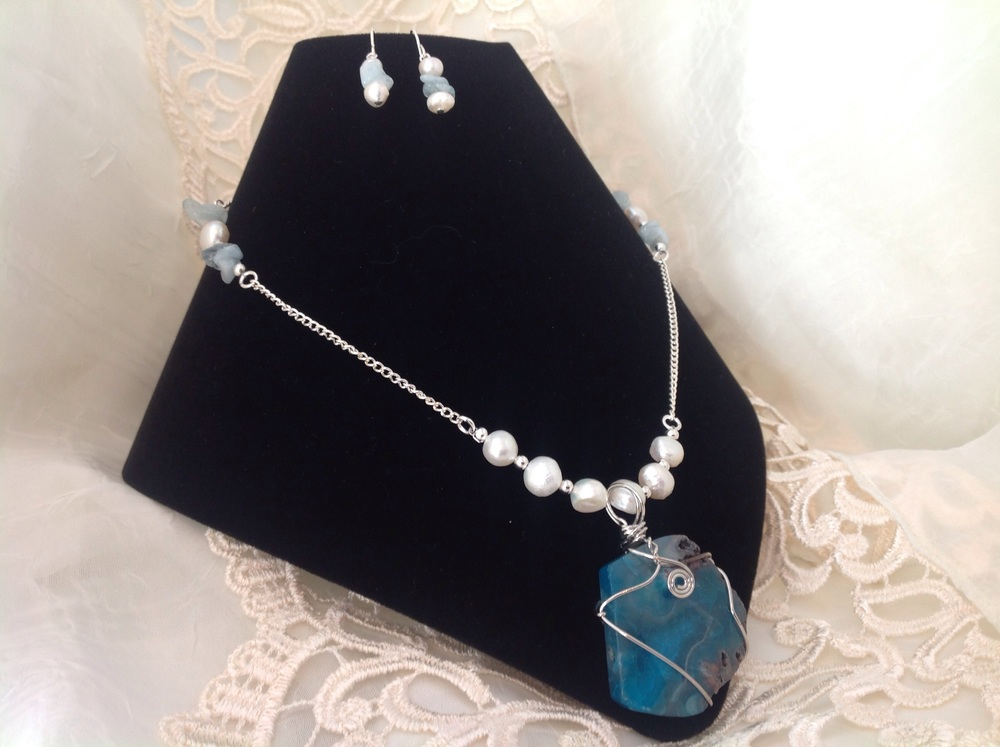 B 45 - Treasured Jewels                                               Debby Scherer Original designs and handcrafted jewelry using semi-precious, natural and man-made materials.