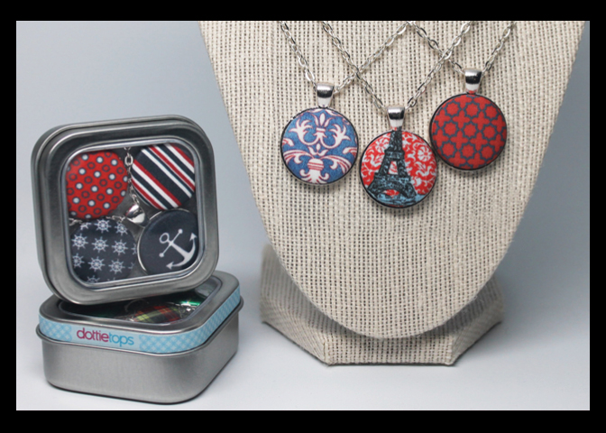 A 61 - DottieTops                                               Mary Sox Interchangeable Jewelry: made by hand, printed fabrics & handmade papers displayed on mini canvas.