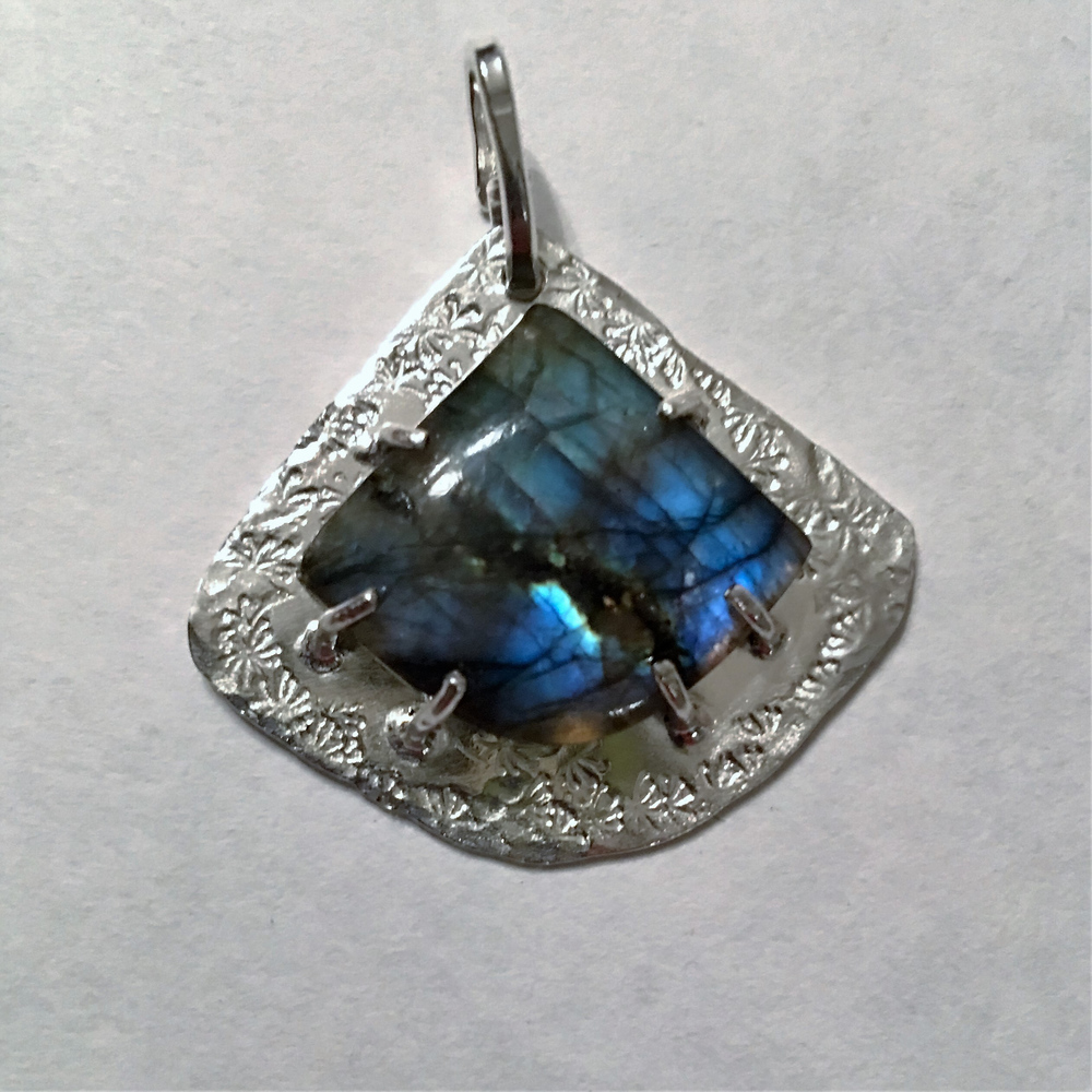 A 50 - Gems by Jeanne Marie                                 Jeanne Steck I manipulate sterling silver or copper sheet & wire with fire, shears,saws & hammers.