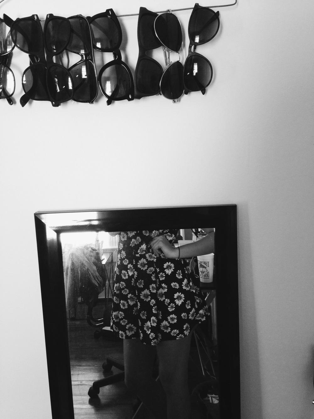 sunglasses & a daisy romper.