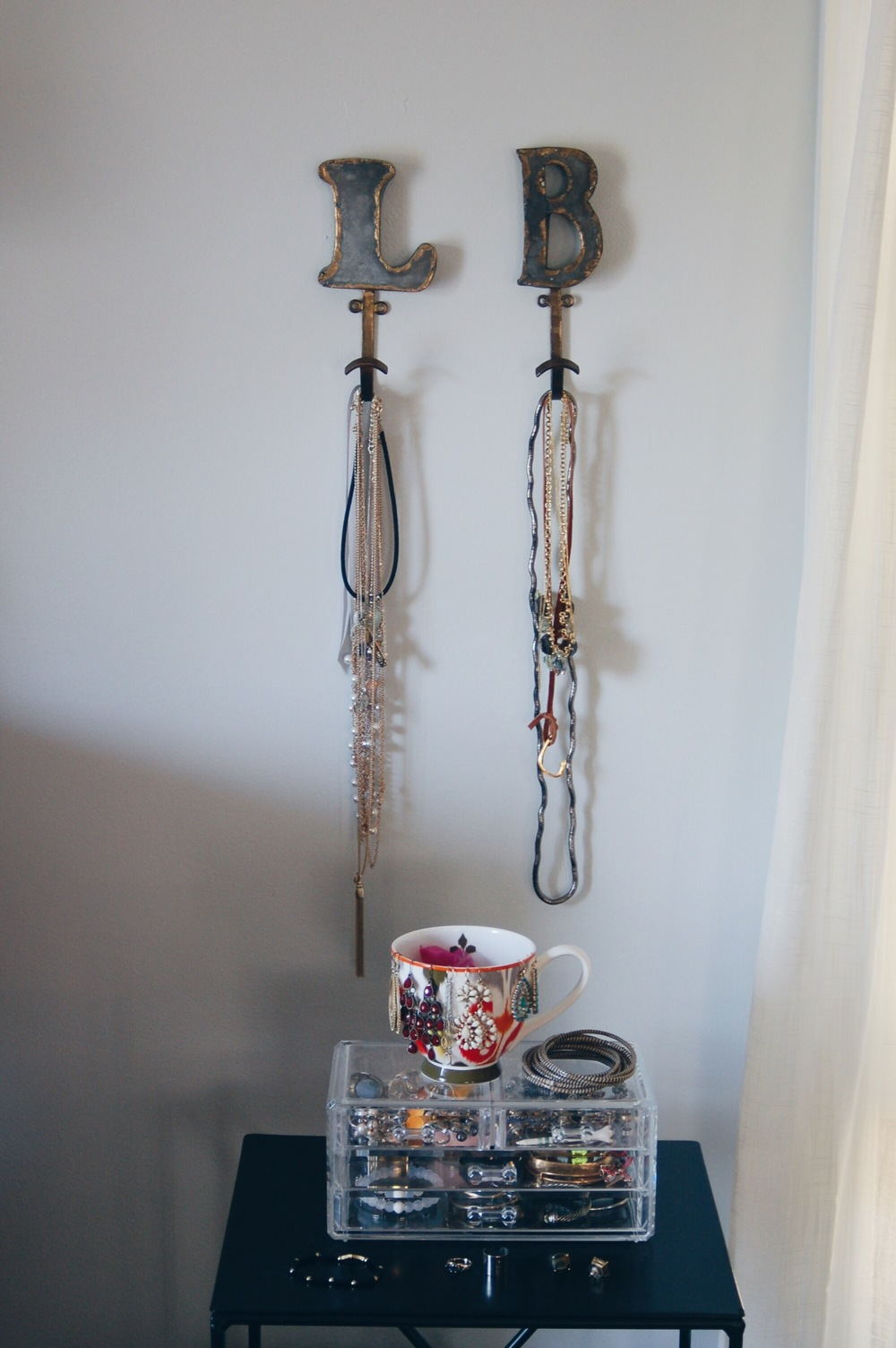 anthro initial hooks become lovely necklace holders.