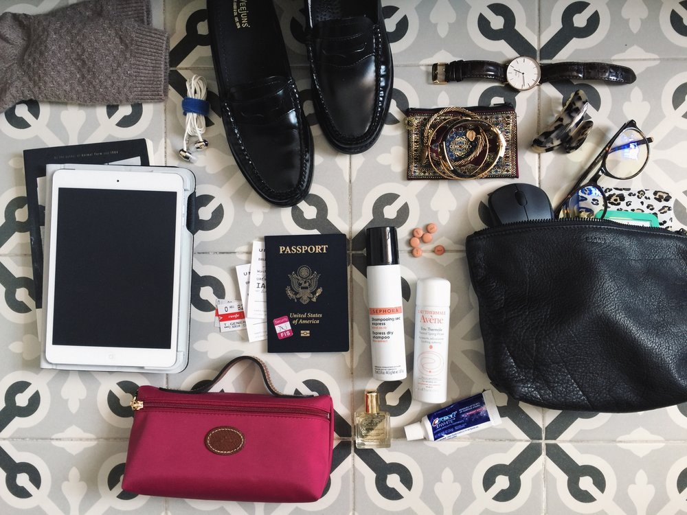 Carry on items for a comfortable flight - +Raggu Cosmetic Bag (I use mine for tech equip.)+Travel toothbrush & toothpaste+Avéne Facial Spray (use once an hour during those long flights!)+Reading material+Headphones+Passport & Tickets+Advil+Tech screen cleaner+Thick socks+Luxe oil+Dry Shampoo