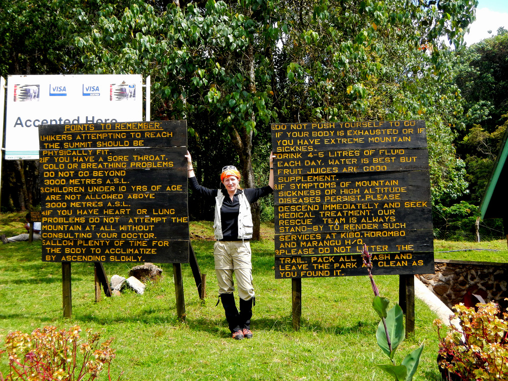12. Sam at entrance to Kili.JPG