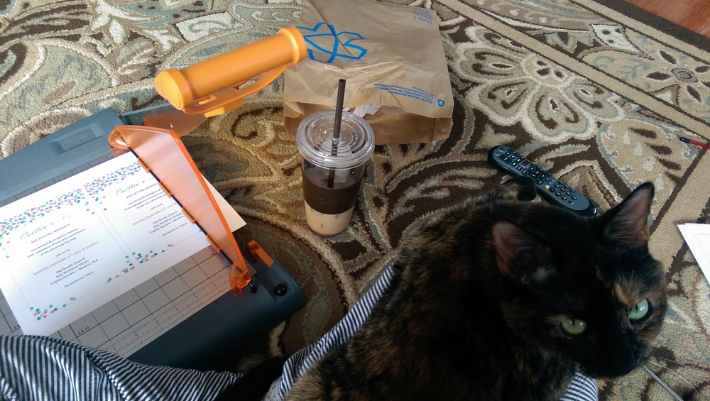 My set up one weekend as I put together invites.  Coffee, my favorite paper cutter, and my cat who refuses to be left out of anything.