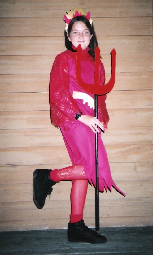 My leg is like that because I'm showing off my super cool tights which I BEGGED my mom to get me. This might be my one and only store bought costume (minus the devil stick thingy my dad helped me make!)