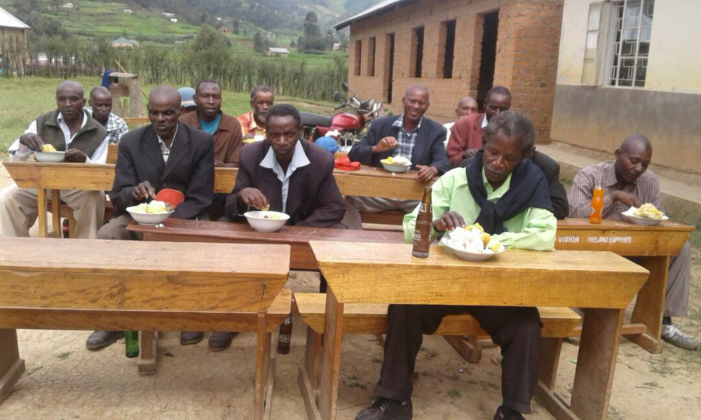 May2017_bucundura_villagers_men_lunch.png