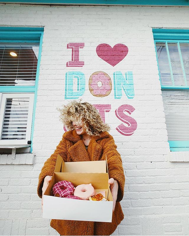 """J🍩Y is the serious business of Heaven!"" -C.S. Lewis . . 📸: @ikeandliv #sundayfunday #joy #fivedaughtersbakery #ilovedonuts #12South #Nashville #donutwall"