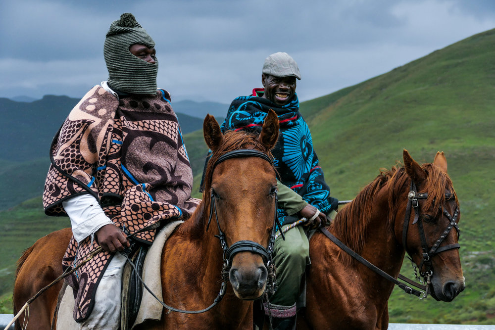 Basotho men wearing traditional Basotho blankets on horses