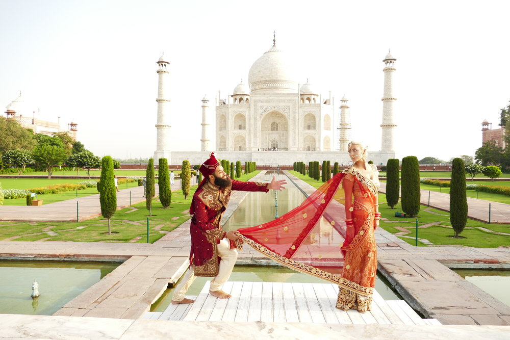 Adrienne McDermott and Andrew McDermott wearing traditional Indian wedding clothes in celebration of their 4th wedding anniversary. Location: Taj Mahal, Agra, India. Photo Credit: @graphikid & @beardseyeview