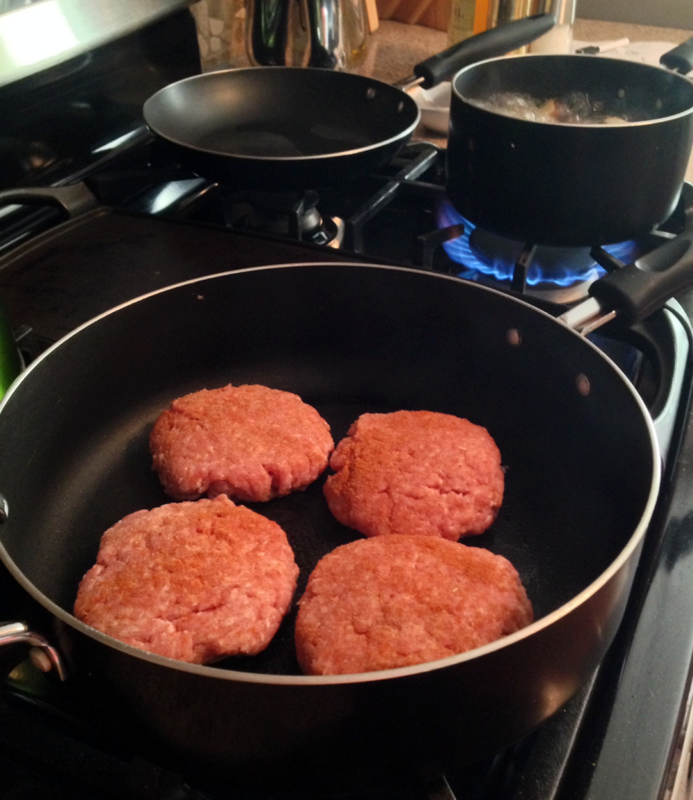 Cook the burgers over medium high heat, turning every 4 minutes 3 times, then cut the biggest one in half to check it is thoroughly cooked.