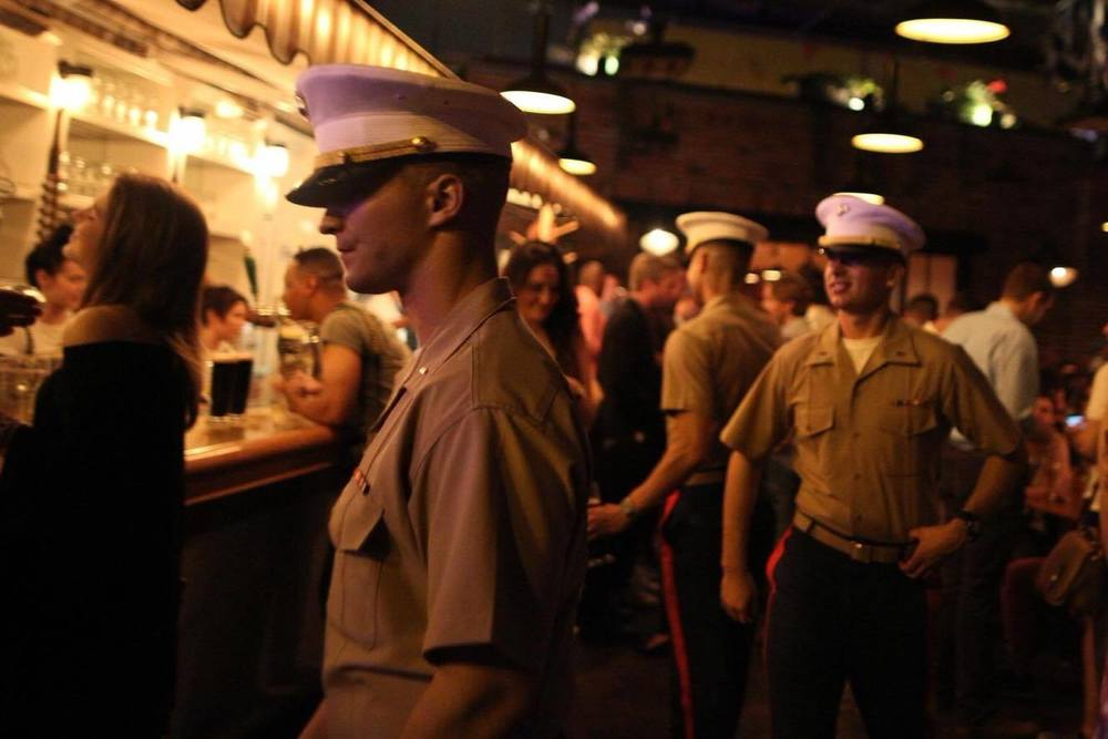 Marines walk through The Standard Biergarten in NYC.