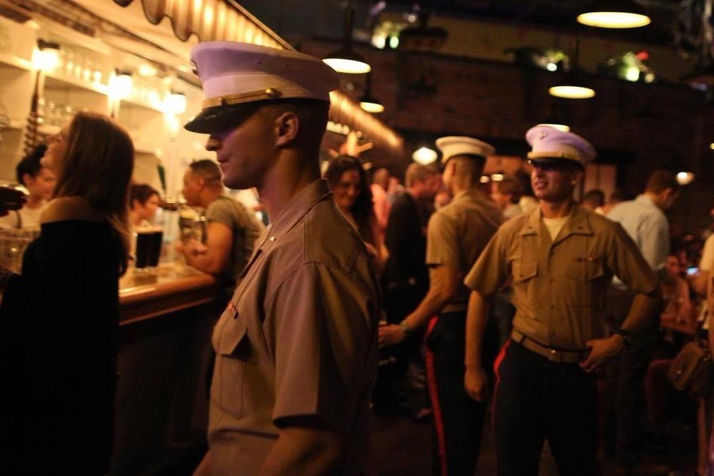 Marines walk through The Standard Biergarten in NYC.