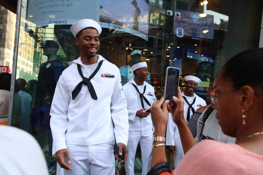 Sailors pose for a photo in TImes Square, NYC