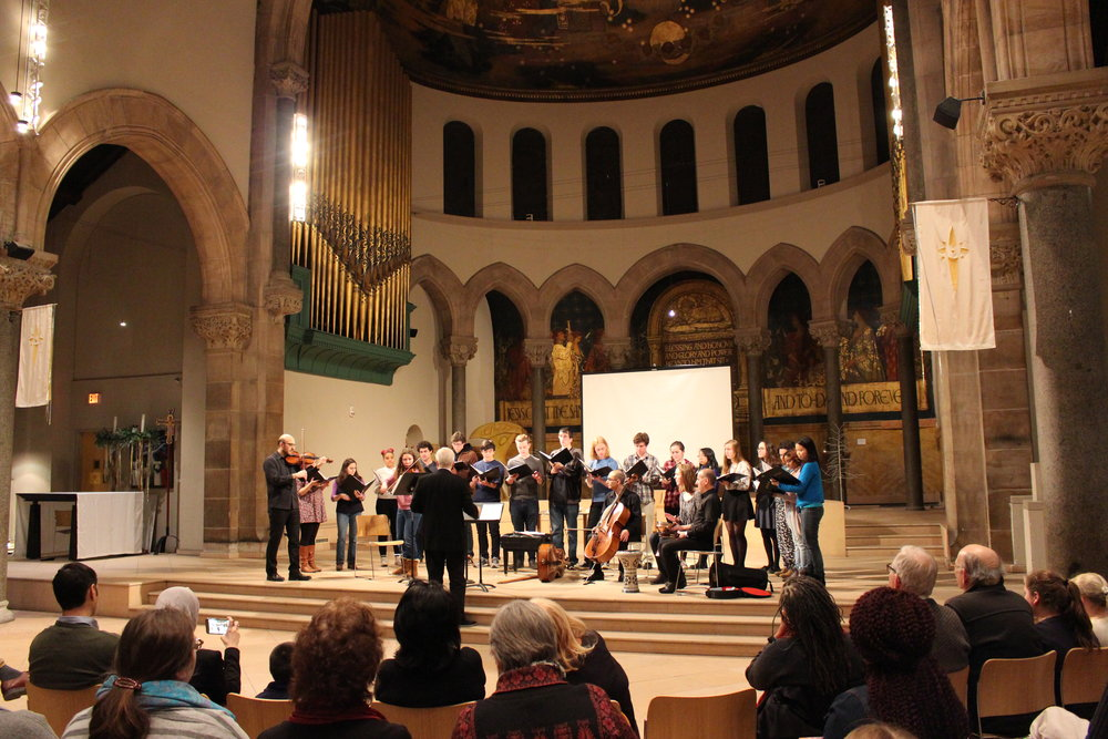 "Chamber Singers performing ""Vogelgesang"" (an arrangement of a German folksong with a Syrian folksong) with the Al Bustan takht ensemble and Thomas Lloyd conducting."