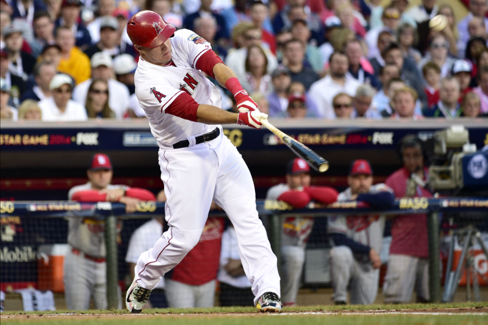 EXACT MOMENT Mike Trout hits a triple off Adam Wainwright.