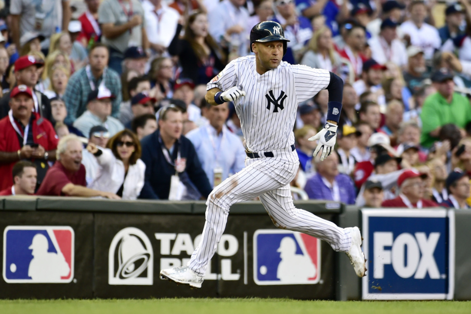 EXACT MOMENT Derek Jeter rounds third to score from second.