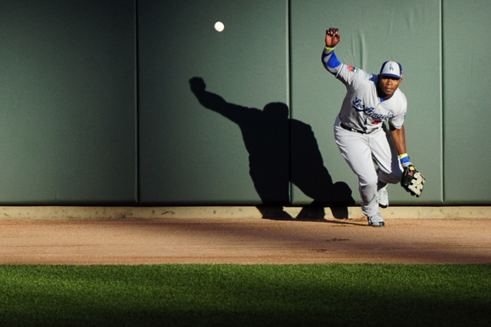 EXACT MOMENT Yasiel Puig chases Trout's off-the-wall triple.