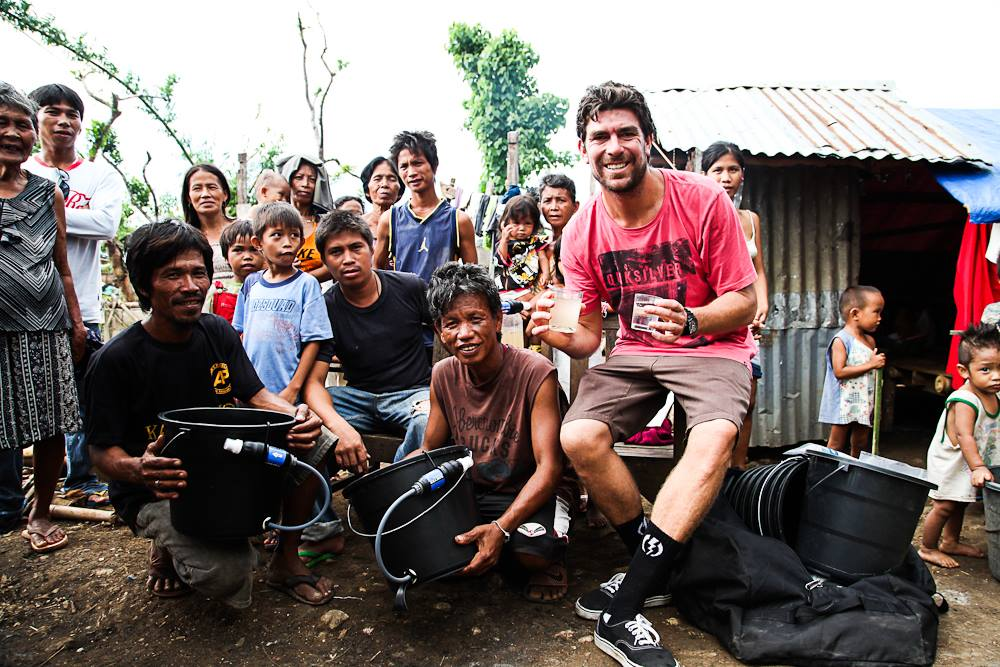 Caleb teaching locals how to use filters for clean water