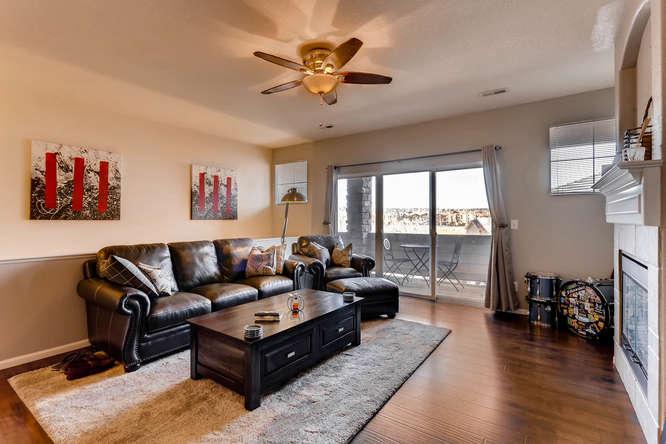 7140 S Wenatchee Way Unit H-small-002-10-Living Room-666x444-72dpi.jpg