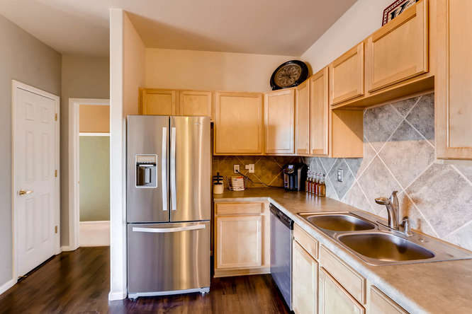 7140 S Wenatchee Way Unit H-small-005-7-Kitchen-666x444-72dpi.jpg
