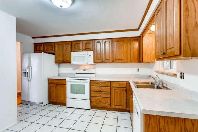 6740 W Jefferson Place-small-009-15-Kitchen-666x444-72dpi.jpg