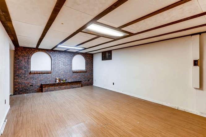 6740 W Jefferson Place-small-021-16-Lower Level Family Room-666x444-72dpi.jpg