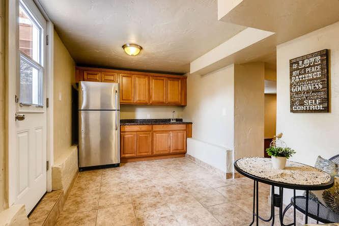 3534 E Bruce Randolph Ave-small-022-17-Lower Level Kitchen-666x444-72dpi.jpg
