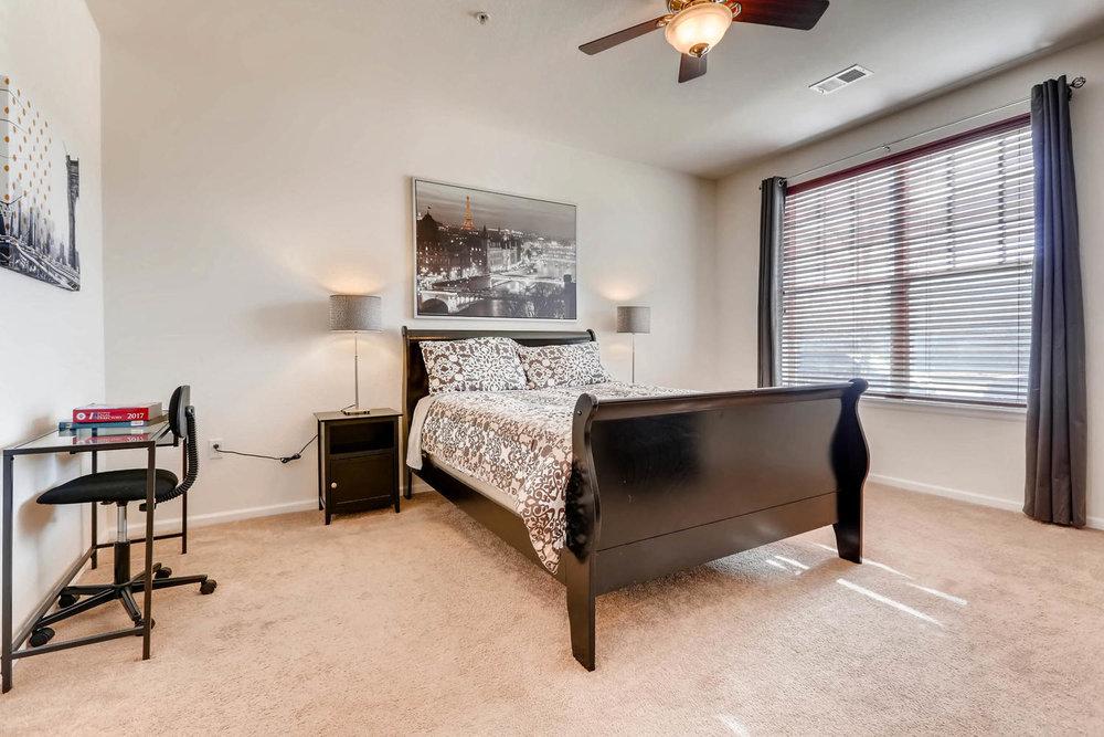 9907 MLK Jr Blvd Unit 104-large-016-15-Master Bedroom-1500x1000-72dpi.jpg