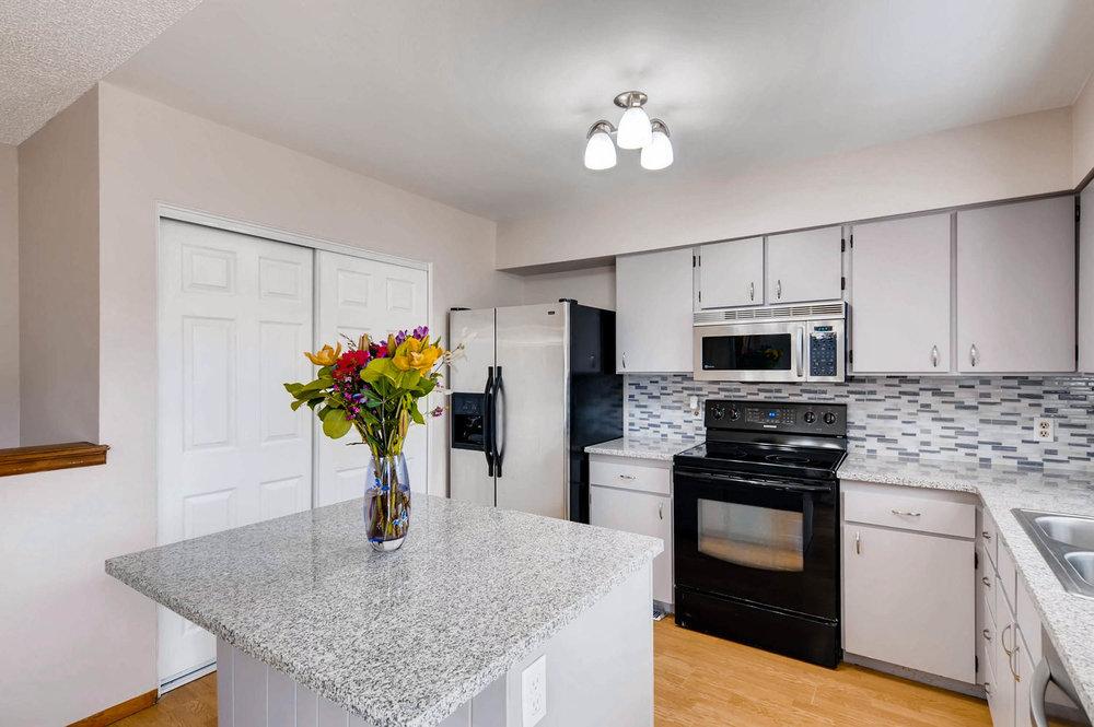2399 Granby Way Aurora CO-large-012-4-Kitchen-1500x997-72dpi.jpg