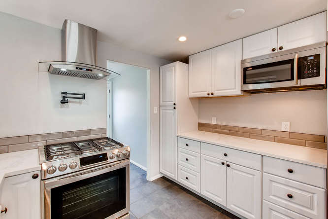 4501 W Short Pl Denver CO-small-012-20-Kitchen-666x444-72dpi.jpg