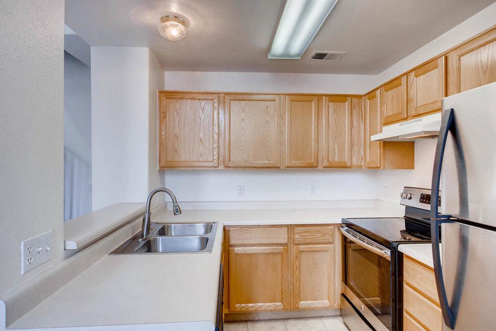 8377 S Upham Way Unit 212-large-009-12-Kitchen-1500x1000-72dpi.jpg