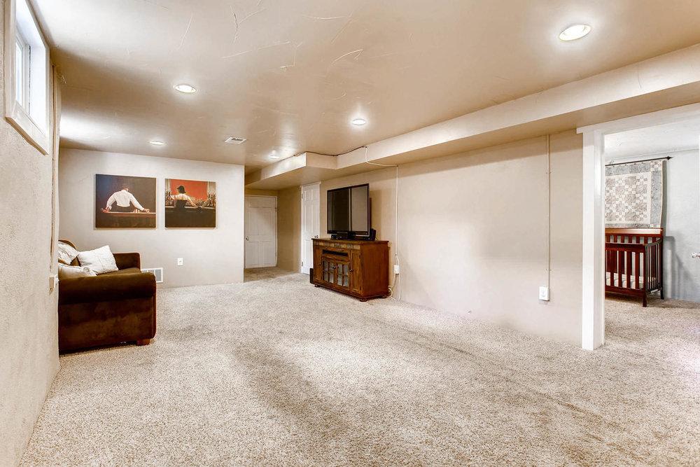 3520 N Columbine St Denver CO-large-021-23-Lower Level Family Room-1500x1000-72dpi.jpg
