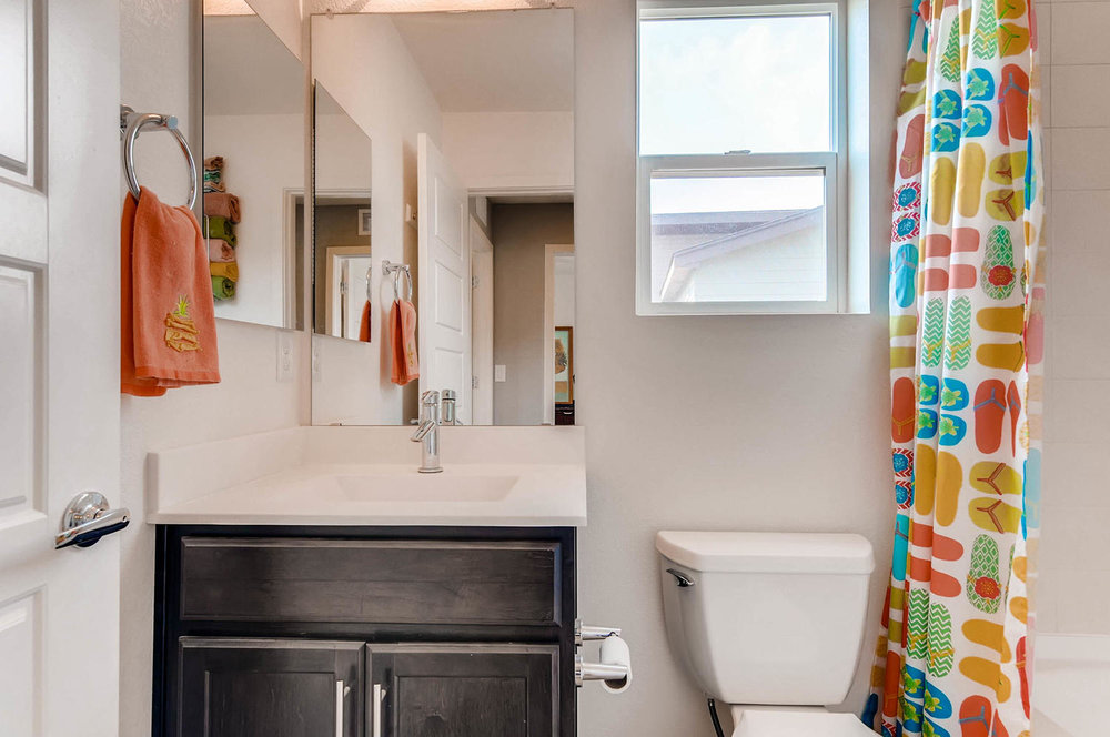10101 Truckee St Commerce City-large-022-17-2nd Floor Bathroom-1500x997-72dpi.jpg