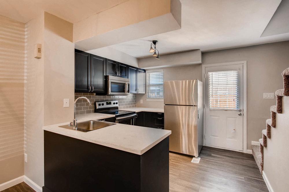 1811 S Quebec Way Unit 224-large-005-4-Kitchen-1500x1000-72dpi.jpg