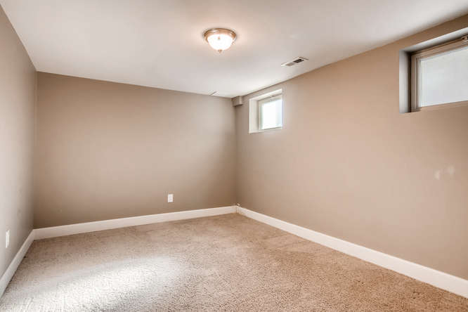 3321 N Race St Denver CO 80205-small-024-6-Lower Level Bedroom-666x444-72dpi.jpg