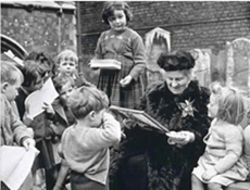 Dr. Montessori with a group of children