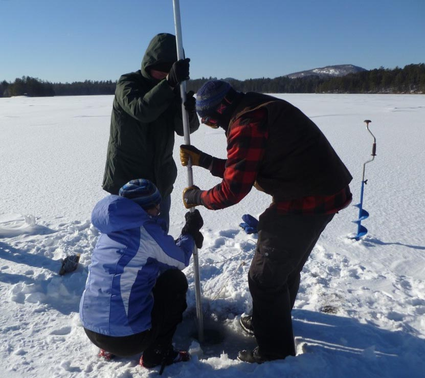 The researchers drilled through snow and ice to extract a sediment core from Lower St. Regis Lake in the Adirondack Mountains of New York State. (Image by Dr. Curt Stager)