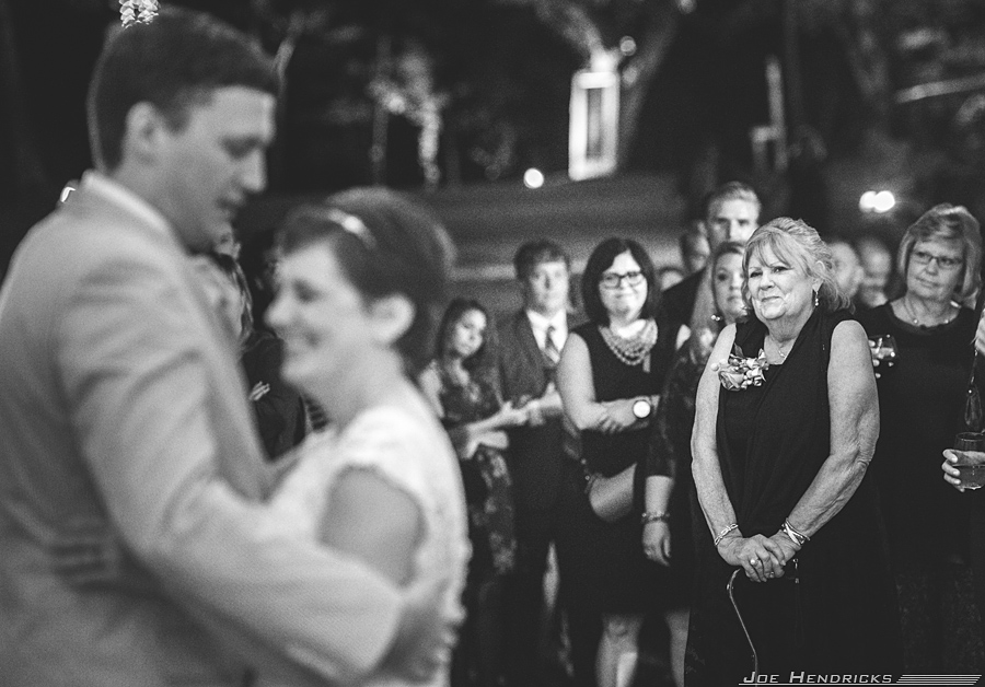 Mom getting emotional while bride dances with husband