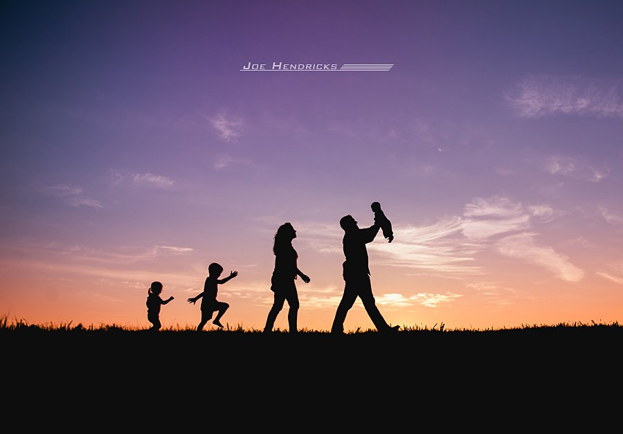 A family at sunset