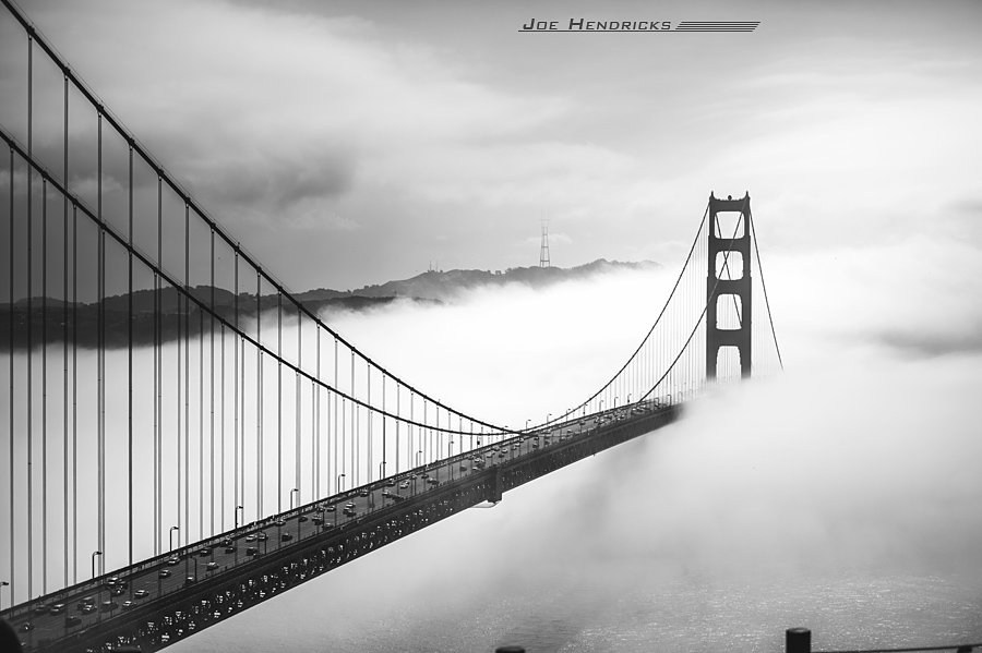 black and white of golden gate in fog