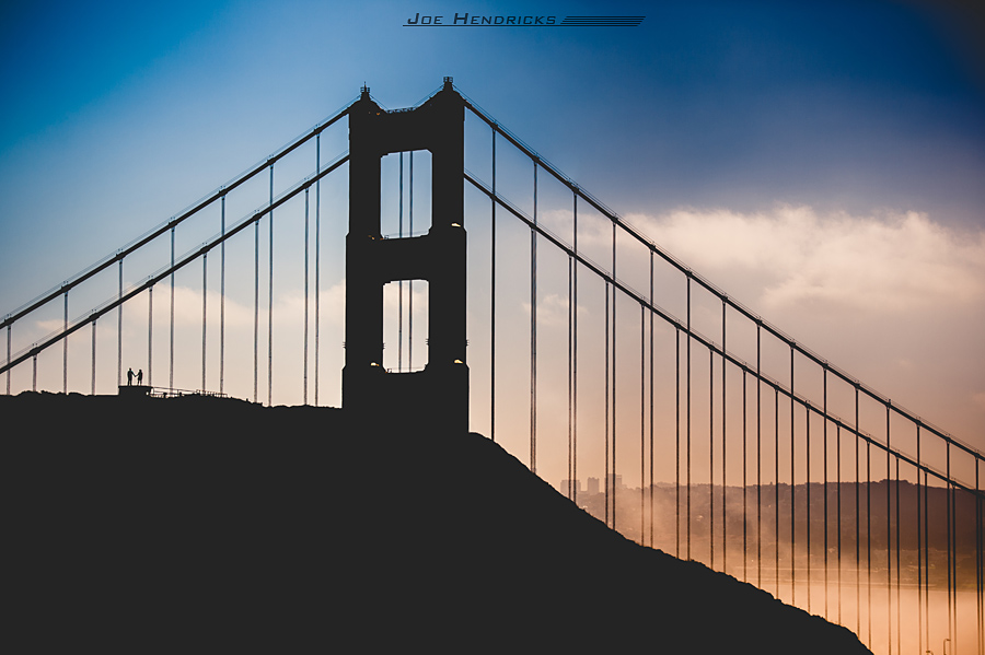 Far away shot of couple on bridge