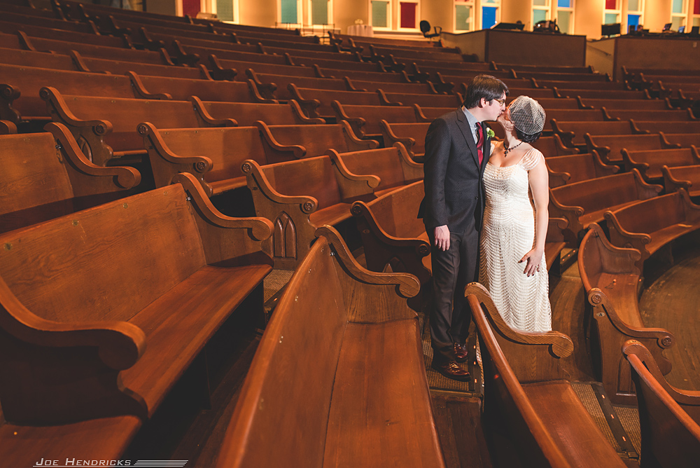 Bride and groom kissing at the ryman