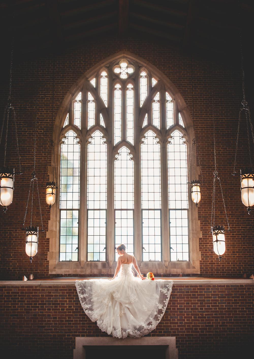 Bride at Scarritt Bennett in front of huge window