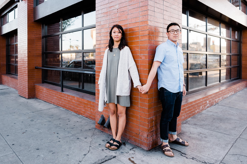 north park urbn restaurant engagement session brick wall