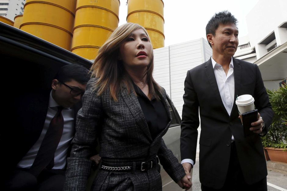 City Harvest Church co-founder Kong Hee (R) has been sentenced to jail for fraudulently diverting millions of dollars to support wife Ho Yeow Sun's (L) pop music career. Photo Credit:  (Reuters: Edgar Su)  (Photo credit from www.abc.net.au)