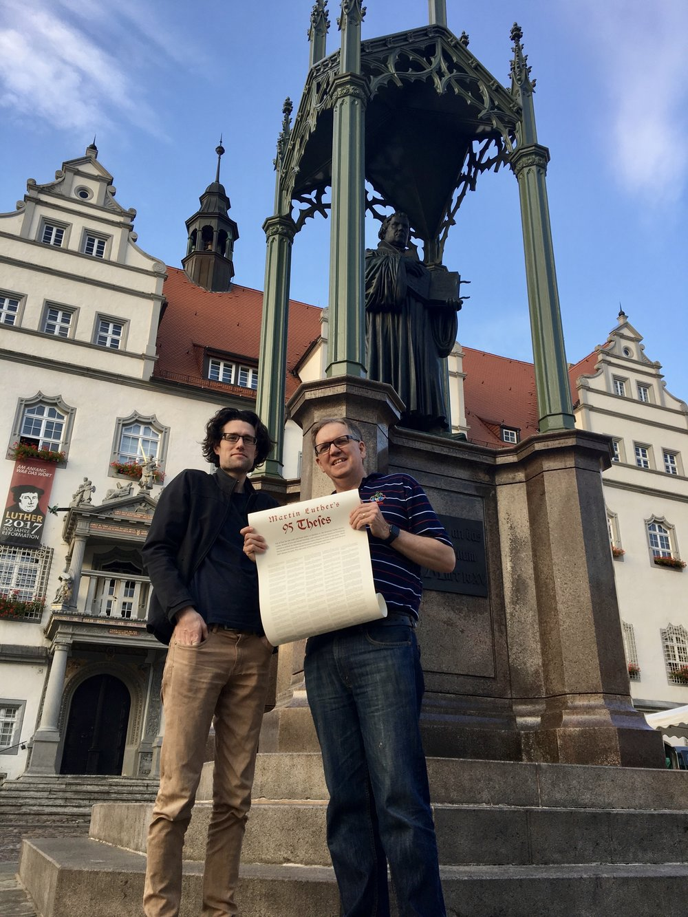 Dominic Steele (right) with Jared Marshall in front of Martin Luther's statue in the main town square of Wittenburg.