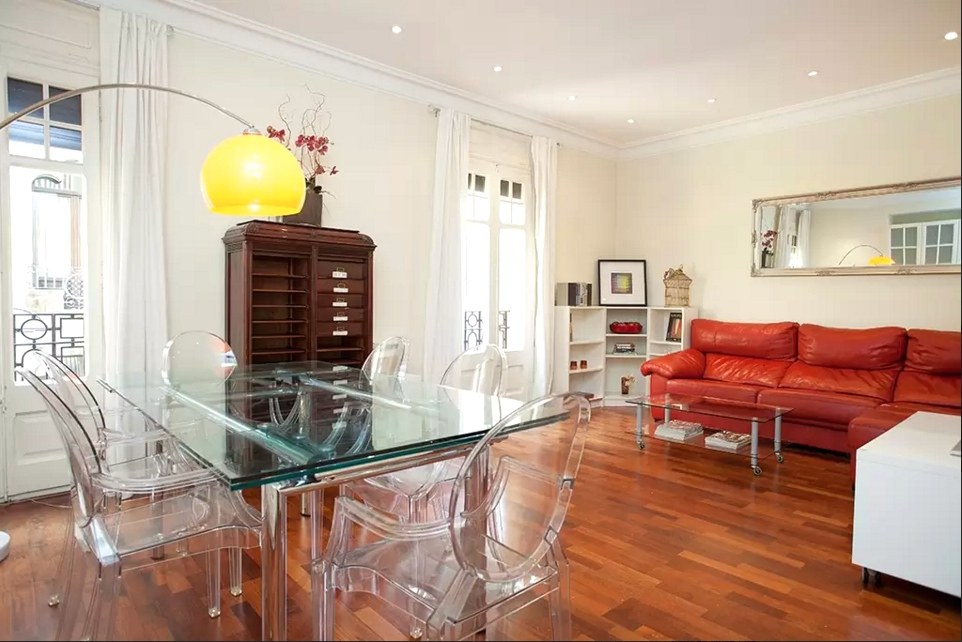 Gracia 1. Wonderfully located just beside the desirable Passeig de Gràcia, this vibrant and quirky flat can comfortably accommodate up to 8 guests. With it's eclectic mix of furniture and bright, airy communal areas and modernist building setting, this is a flat not to be missed!   Book now with airbnb!